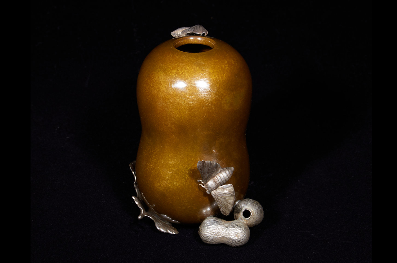 Vase in the form of a silkworm cocoon